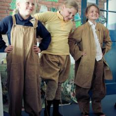 Girls trying out Women's Land Army clothes
