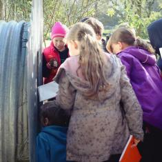 Newlyn School pupils looking in the WW2 shelter